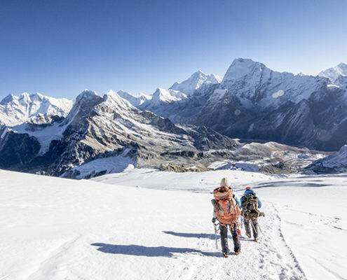 Woman mountaineer & climbing sirdar descend Mera Peak, Everest in view
