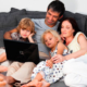 Young family on a sofa with a laptop